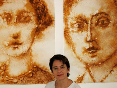 Esther Solondz with large rust painted portraits